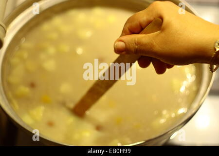making traditional noah pudding asure on oven - Stock Photo