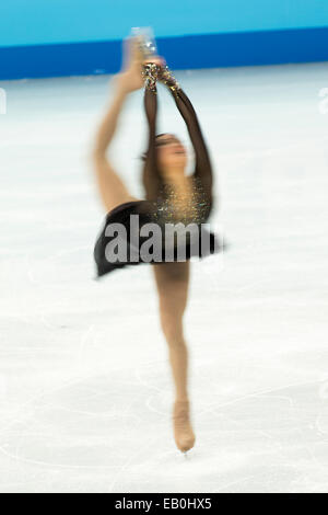 Burred action of woman competing in the Figure Skating Free Skate at the Olympic Winter Games, Sochi 2014 - Stock Photo