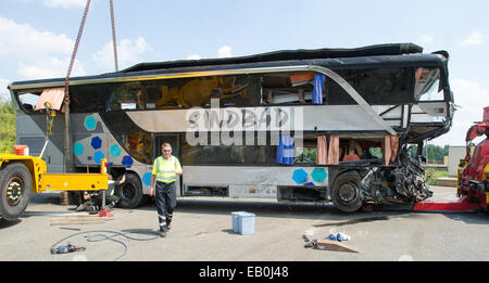 FILE - An archive picture dated 19.07.2014 shows a wrecked tourist bus with the label of Polish travel company Sinbad - Stock Photo