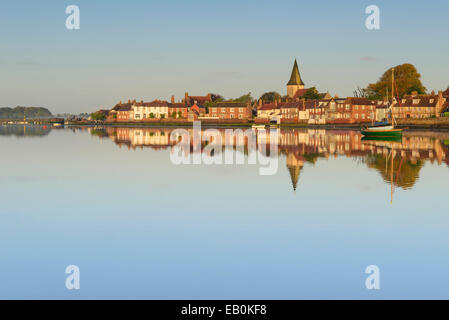 looking across the calm waters of bosham harbour in early morning light showing the church and buildings of this - Stock Photo