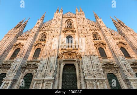 Duomo di Milano at sunset  Cathedral church of Milan, Italy. Dedicated to Santa Maria Nascente (Saint Mary Nascent). - Stock Photo
