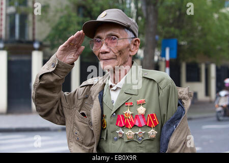 Vietnamese military veteran saluting outside of Ho Chi Minh Mausoleum in Hanoi Vietnam - Stock Photo
