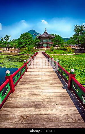 Wooden Bridge Leading to the Pavilion of Far-Reaching Fragrance, Gyeongbokgung Palace; Seoul, South Korea - Stock Photo