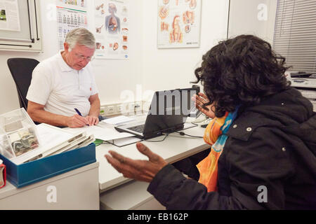 Hamburg, Germany. 06th Nov, 2014. Volunteering physician Detlev Nieburh from Malteser-Migranten-Medizin (Maltese - Stock Photo