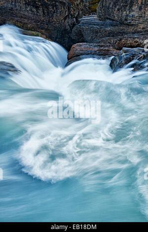 Glacier fed Kicking Horse River at Natural Bridge Falls in British Columbia's Canadian Rockies and Yoho National - Stock Photo