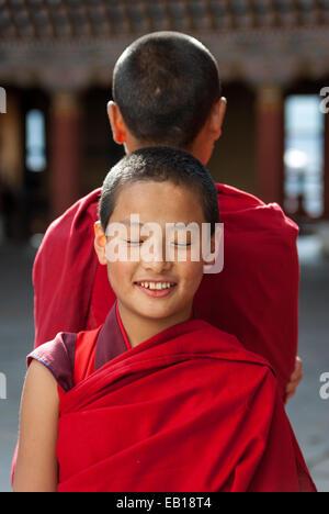 Young Bhutanese Buddhist monks at Paro Dzong, Bhutan - Stock Photo