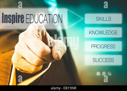 Businessman pressing a Good Education concept button. - Stock Photo