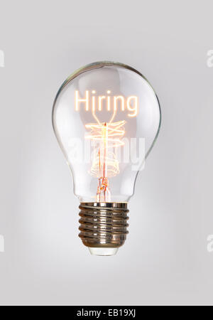 Hiring, human resources concept in a filament lightbulb. - Stock Photo