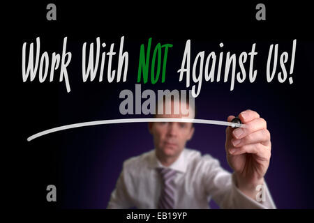 A businessman writing Work With Us Not Against Us on a screen. Business Concept. - Stock Photo