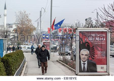 Nov. 24, 2014 - Gjilan, Kosovo - Pedestrians walk aside a banner on Monday, November 24, 2014, which is noting the - Stock Photo