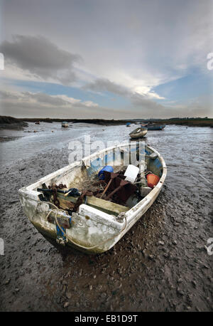 grounded dinghy morston quay north norfolk england - Stock Photo