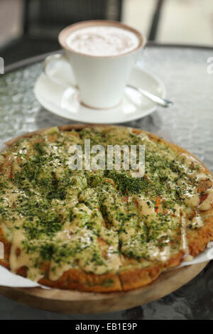 Pizza Japanese style with hot chocolate in cafe - Stock Photo