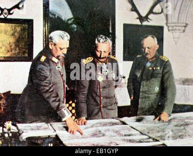 The contemporary colorized German propaganda photo shows the German Supreme Army Command (OHL) during a briefing - Stock Photo