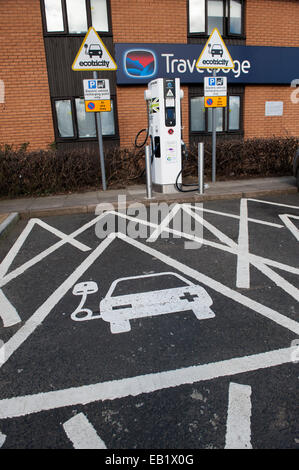reserved parking bay at motorway services for electric cars at a recharging point, UK - Stock Photo