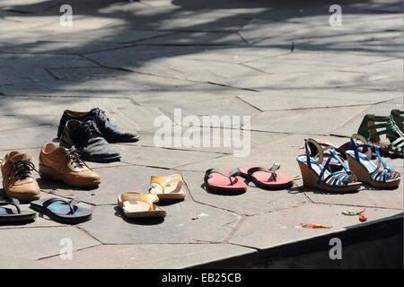 The shoes of the devotees wait for their owners to end visiting the Taal Barahi Mandir-hindu temple devoted to goddess - Stock Photo