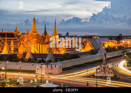 Grand palace at twilight with light from traffic in Bangkok, Thailand - Stock Photo
