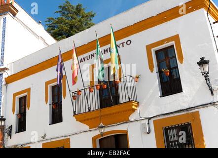 Ayuntamiento town hall building with flags in village of Alajar, Sierra de Aracena, Huelva province, Spain - Stock Photo
