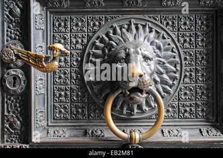 Lion head door knocker on the entrance portal, Cologne Cathedral, Cologne, Rhineland, North Rhine-Westphalia, Germany