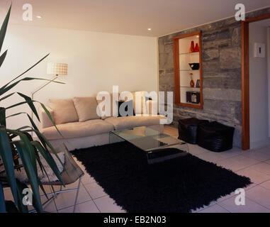 Coffee table on rug in front of sofa in living room in The Grainstore, Perthshire, Scotland - Stock Photo