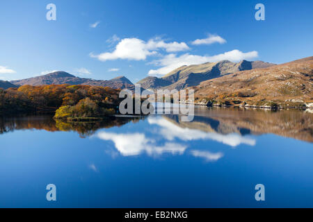 The MacGillycuddy's Reeks mountains reflected in Upper Lake, Killarney National Park, County Kerry, Ireland.