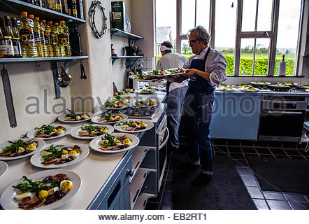 Chefs in a kitchen at Ballymaloe Cookery School. - Stock Photo