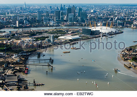An aerial view of sailing dinghies competing in a race on the Thames river near Docklands with views of the O2 and - Stock Photo