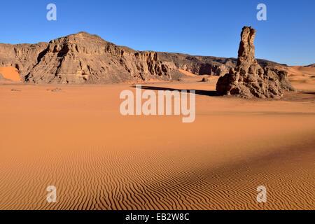 Sand dunes and rocks of Moul Naga, Tadrart, Unesco World Heritage Site Tassili n' Ajjer National Park, Sahara desert, - Stock Photo