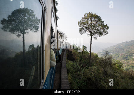 Train of the Kalka–Shimla Railway, a narrow gauge railway, slowly winding its way up from Kalpa to Shimla, near - Stock Photo
