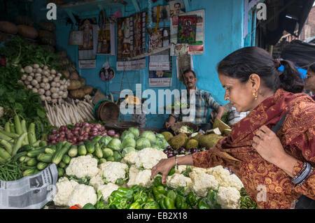 Local woman buying cauliflower at the market, Shimla, Himachal Pradesh, India - Stock Photo