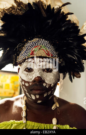 A Spirit dancer decorated in facial paint, shell necklace, beads and a feathered headdress. - Stock Photo