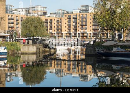 St. Katharine Docks, London, UK. 24th November 2014. A sunny but cold winter's scene at St. Katharine Docks in London - Stock Photo
