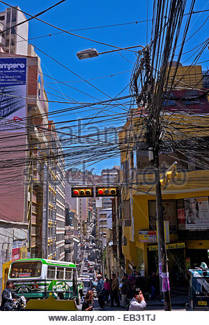 An amazing jumble of electric lines connected to one utility pole on a street in down town La Paz. - Stock Photo