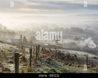 Eyam, Derbyshire Peak District, UK. 25th November, 2014. Mist and frost cover 'plague village' Eyam. Credit:  Paul - Stock Photo