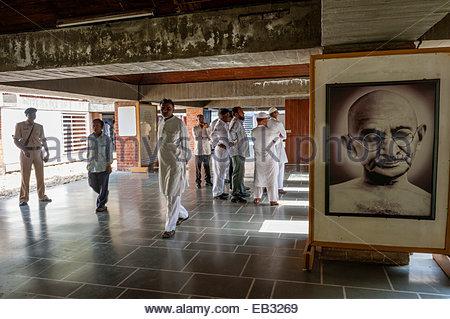 A large black and white portrait of Gandhi hangs inside the Sabarmati Ashram museum. - Stock Photo