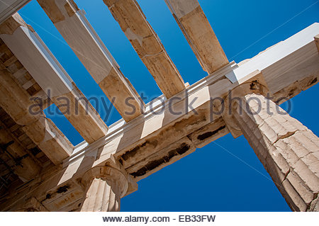 Ancient columns of the Propylaea at the Acropolis in Athens, Greece - Stock Photo