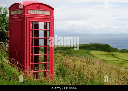 English phone booth in the middle of the countryside, Isle of Mull, Scotland, United Kingdom - Stock Photo