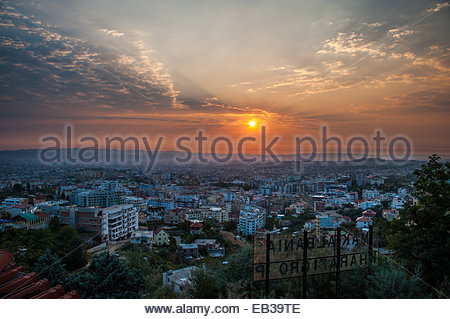 The sun sets over Tirana, Albania. - Stock Photo