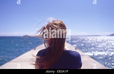 France, Juan les Pins, Rear view of woman with wind blowing - Stock Photo