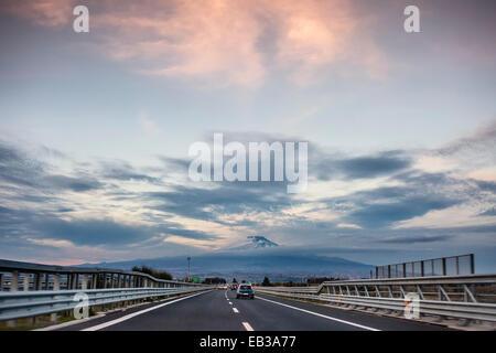 Italy, Sicily, Catania, View along highway with Mount Etna on horizon - Stock Photo
