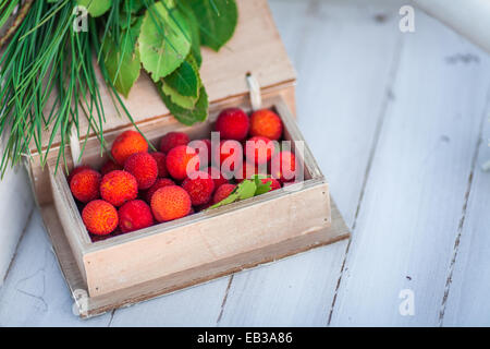 Wooden box of lychee fruit - Stock Photo