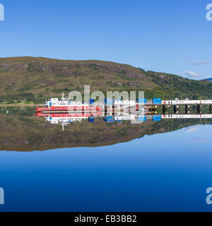 UK, Scotland, View of harbor and hill reflecting in water - Stock Photo