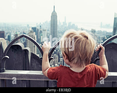 USA, New York State, New York City, Boy (2-3) looking at city - Stock Photo