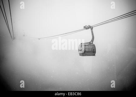 Canada, British Columbia, Gondola in heavy snow fall in Whistler - Stock Photo