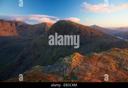 Dawn view towards Carrauntoohil and Broaghnabinnia from Stumpa Duloigh, Macgillycuddy's Reeks , County Kerry, Ireland. - Stock Photo