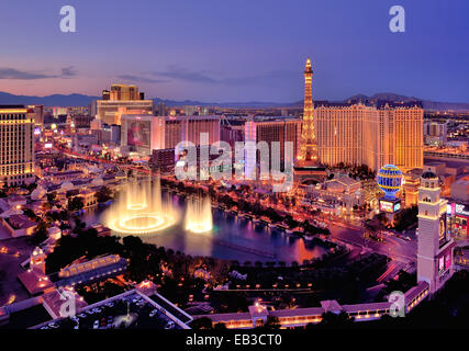 City skyline at night with Bellagio Hotel water fountains, Las Vegas, Nevada, America, USA - Stock Photo