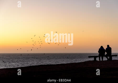 Chile, Two people on beach at sunset - Stock Photo