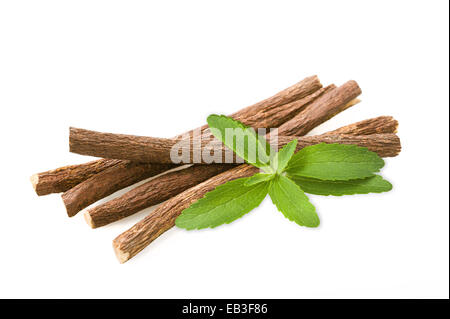 Roots licorice and stevia isolated on white - Stock Photo