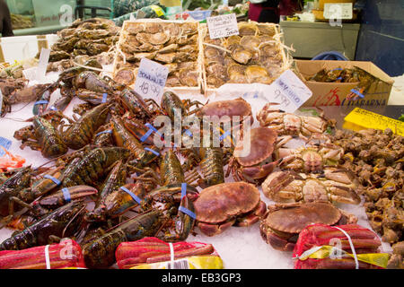 Stall displays fresh seafood including crabs and lobster for sale in the La Boqueria public market Barcelona,Spain - Stock Photo
