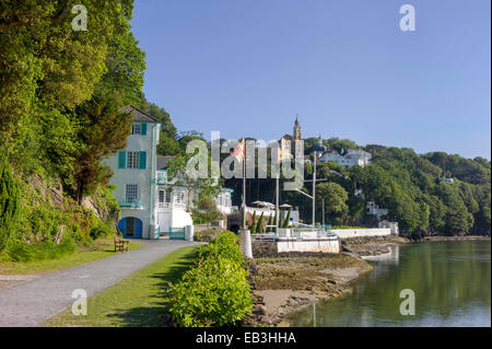 Portmeirion Hotel, quayside walk, Portmeirion village in the wooded background, on the estuary of the river Dwyryd. - Stock Photo