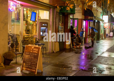 Young musician buskers in downtown Victoria  at night-Victoria, British Columbia, Canada. - Stock Photo